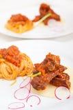 Pasta with pork ribs sauce on polenta bed Royalty Free Stock Photos