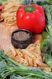 Pasta preparations. Beautiful shot of pasta with vegetables and seasoning Royalty Free Stock Photo