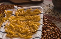 Pasta prepared to be cooked by hand stock photography