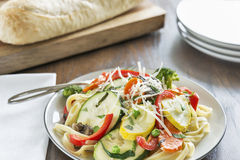 Pasta primavera with fettuccine and garden vegetab Royalty Free Stock Images
