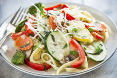 Pasta primavera with fettuccine and garden vegetab Stock Images