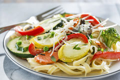 Pasta primavera with fettuccine and garden vegetables Royalty Free Stock Photos