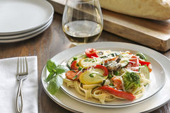 Pasta primavera with fettuccine and garden vegetables Royalty Free Stock Image