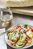 Pasta primavera with fettuccine and garden vegetables Stock Photo