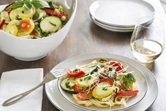 Pasta primavera with fettuccine and garden vegetables Stock Photography