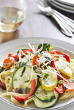 Pasta primavera with fettuccine and garden vegetables Royalty Free Stock Photo