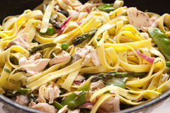 Pasta Primavera with Poached Salmon Stock Image
