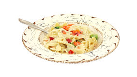 Pasta Primavera in southwestern bowl with fork Stock Photo