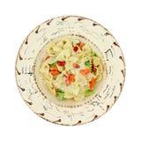 Pasta Primavera in southwestern style bowl. A single serving of pasta Primavera in a southwestern style bowl on a white background Royalty Free Stock Photos
