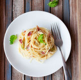 Pasta with prosciutto. Italian pasta with cheese, prosciutto and basil on vintage rustic wooden background Stock Photo