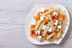Pasta with pumpkin and feta on the table. top view Royalty Free Stock Photos