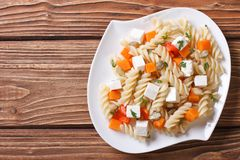 Pasta with pumpkin and feta on a white plate. top view Royalty Free Stock Photo