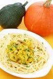 Pasta with pumpkin sauce Stock Images