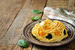 Pasta with pumpkin and spinach Stock Photo