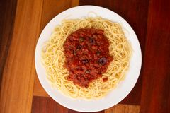 Pasta Puttanesca shot from Above. No utensils stock photo