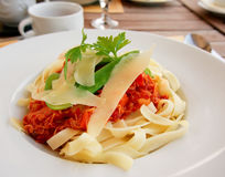 Pasta with rabbit meat and tomato sauce Stock Photo
