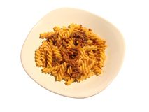 Pasta with ragout in dish. Pasta with tomato, mushroom and meat sauce dish Royalty Free Stock Photography