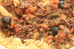 Pasta and ragu. Pasta on a plate: Fusilli with ragu, cheese and black olives Royalty Free Stock Photography