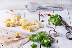 Pasta ravioli on flour with basil Royalty Free Stock Photography