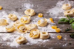 Pasta ravioli on flour. Homemade pasta ravioli over wooden table with flour Royalty Free Stock Images