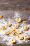 Pasta ravioli on flour. Homemade pasta ravioli over wooden table with flour Royalty Free Stock Image