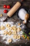Pasta ravioli on flour Stock Photos