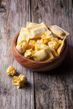 Pasta ravioli in wooden bowl Stock Photos