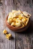 Pasta ravioli in wooden bowl Stock Photos