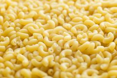 Pasta raw closeup background. Delicious dry uncooked ingredient for traditional Italian cuisine dish. Textured variety Stock Images