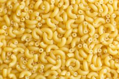 Pasta raw closeup background. Delicious dry uncooked ingredient for traditional Italian cuisine dish. Textured variety Stock Photography