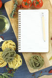 Pasta recipe. Blank recipe book with pasta on the table Royalty Free Stock Photography