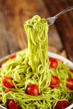 Pasta recipe with avocado and tomatoes Stock Photos