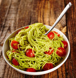 Pasta recipe with avocado and tomatoes Stock Images