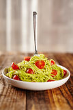 Pasta recipe with avocado and tomatoes Stock Photo