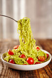 Pasta recipe with avocado and tomatoes Stock Image