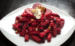 Pasta with Red Beets Cheese and Walnuts Stock Image