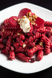 Pasta with Red Beets Cheese and Walnuts Stock Photography