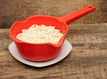 Pasta in red colander Royalty Free Stock Photography