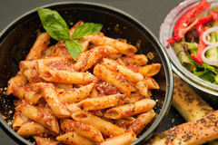 Pasta with red hot sauce royalty free stock photo