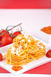 Pasta with red pesto sauce Stock Photography