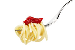 Pasta with red sauce on a fork Stock Photo
