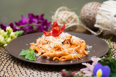 Pasta with red sauce. Penne funghi. Italian quisine Stock Images