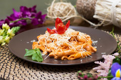Pasta with red sauce. Penne funghi. Italian quisine Stock Photos
