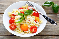Pasta with red and yellow cherry tomatoes Royalty Free Stock Images