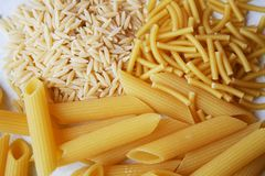 Pasta and rice, Italian cereals. In this image there is an assortment of pasta and rice, namely Italian cereals. Pasta is a very popular product in Italy and stock images