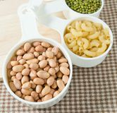 Pasta, Rice, Peanuts and Moong Beans in Measuring Cups Stock Image