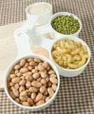 Pasta, Rice, Peanuts and Mung Beans in Measuring Cups Royalty Free Stock Photo