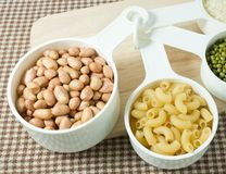 Pasta, Rice, Peanuts and Mung Beans in Measuring Spoons Stock Photography