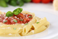 Pasta  Rigate Napoli with tomato sauce noodles meal with basil Stock Photography
