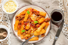 Pasta rigatoni in bolognese sauce with ground meat Stock Image